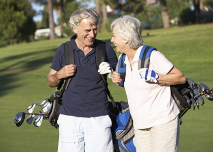 Senior-Couple-Playing-Golf